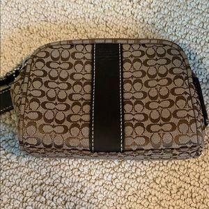 Small Coach makeup bag